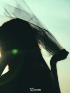 Silhouette of woman in the summer sun.